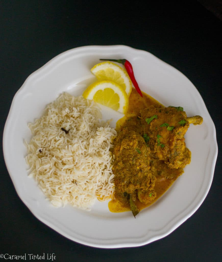 Chicken Chettinad with rice on a plate