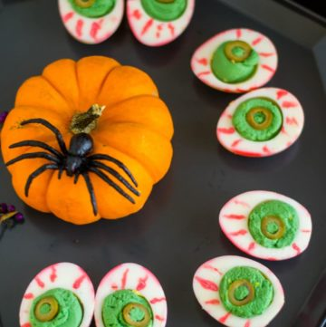 Halloween Deviled Eggs with a pumpkin and spider