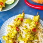 Chicken satay kewers served on rice noodles