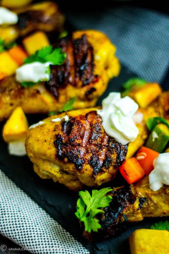 Grilled Chicken Tikka Drumsticks served on a plate