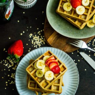 Waffles with bananas, strawberries on a plate