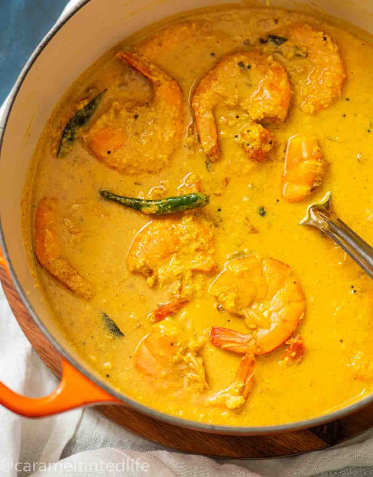 a dutch oven with shrimp curry