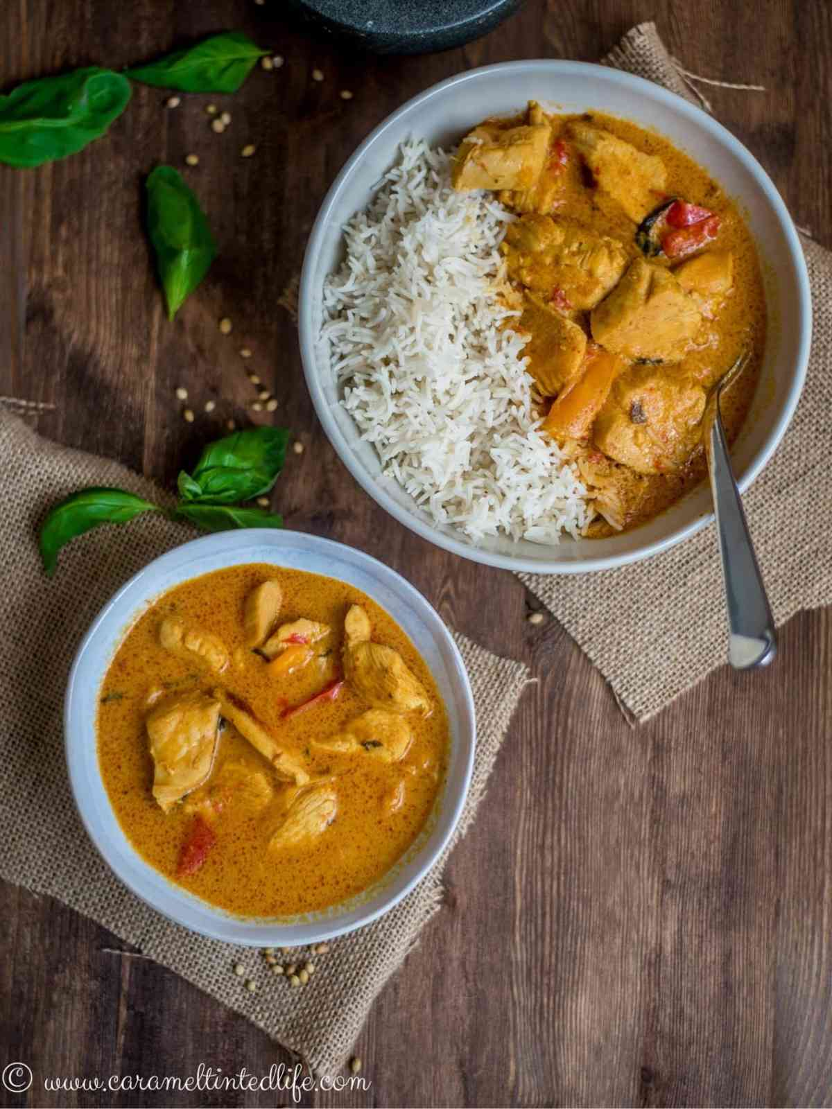 Two bowls of thai chicken curry and rice