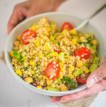 Bulgur Salad with chickpeas, cherry tomatoes, cucumber, served in a bowl