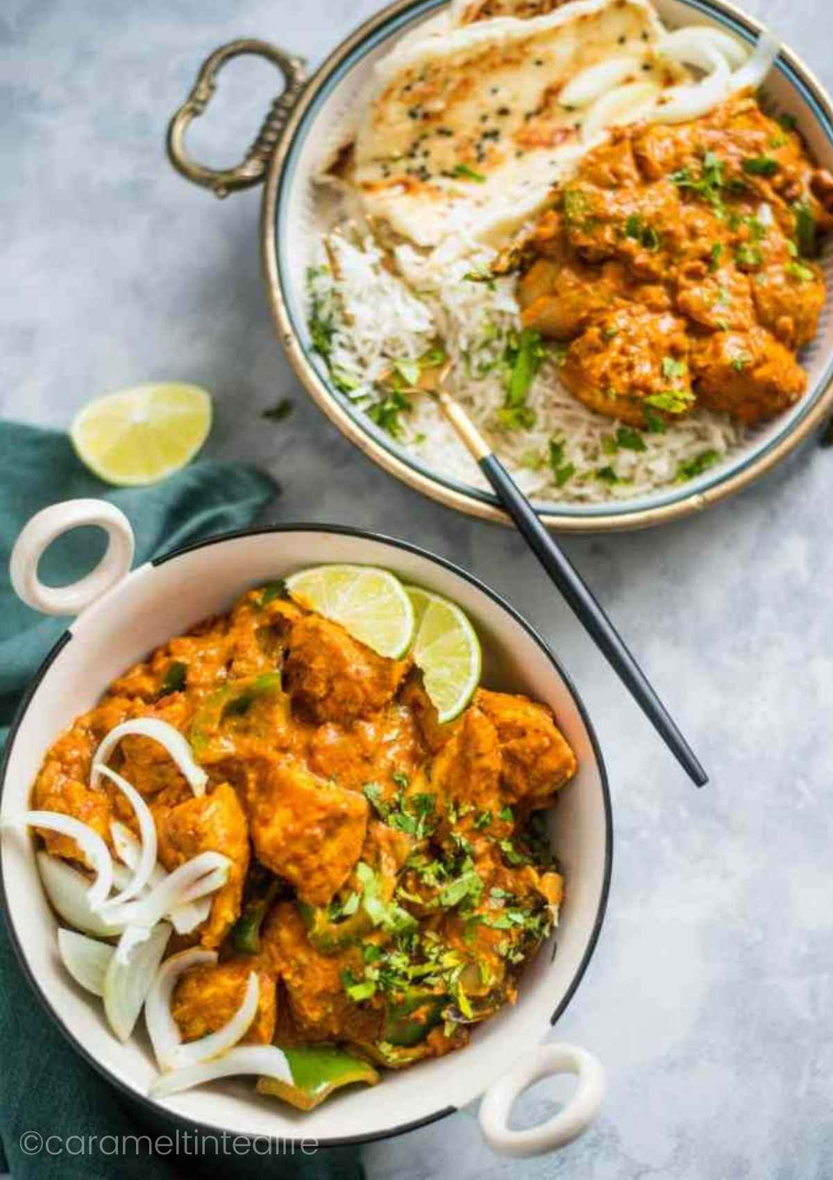 Kadai Chicken served with rice and naan viewed from the top
