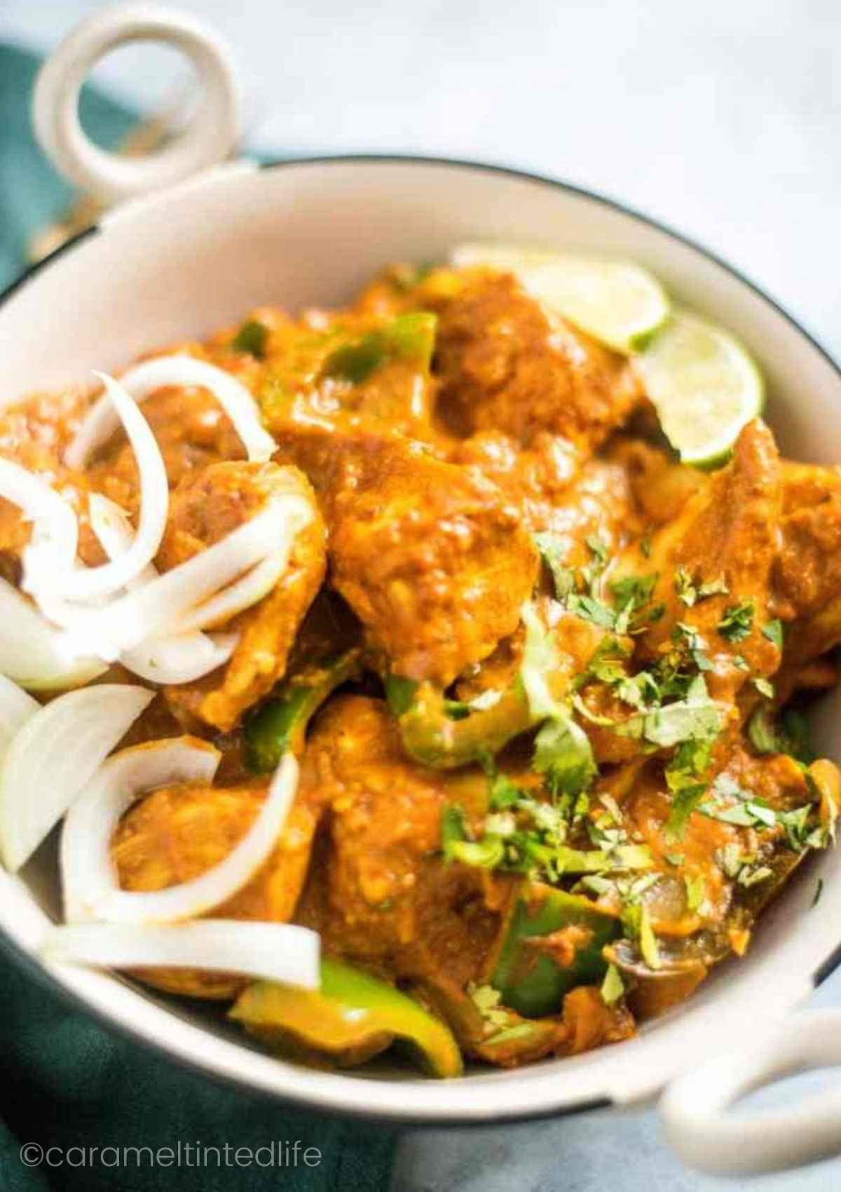 Kadai Chicken served in a bowl with rice