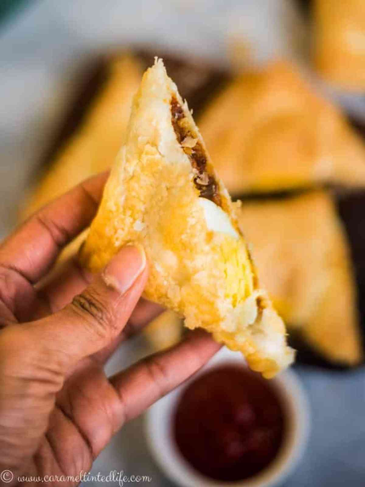 Sliced egg puffs held in a hand