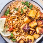 Noodle bowl with noodles, paneer, peanuts, stir-fried veggies
