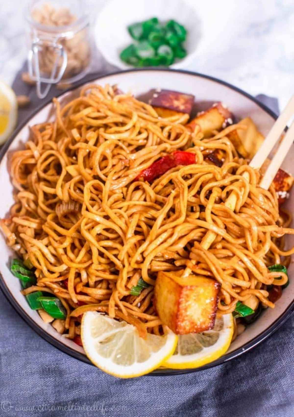 Noodle bowl with noodles, stir-fried veggies and toppings
