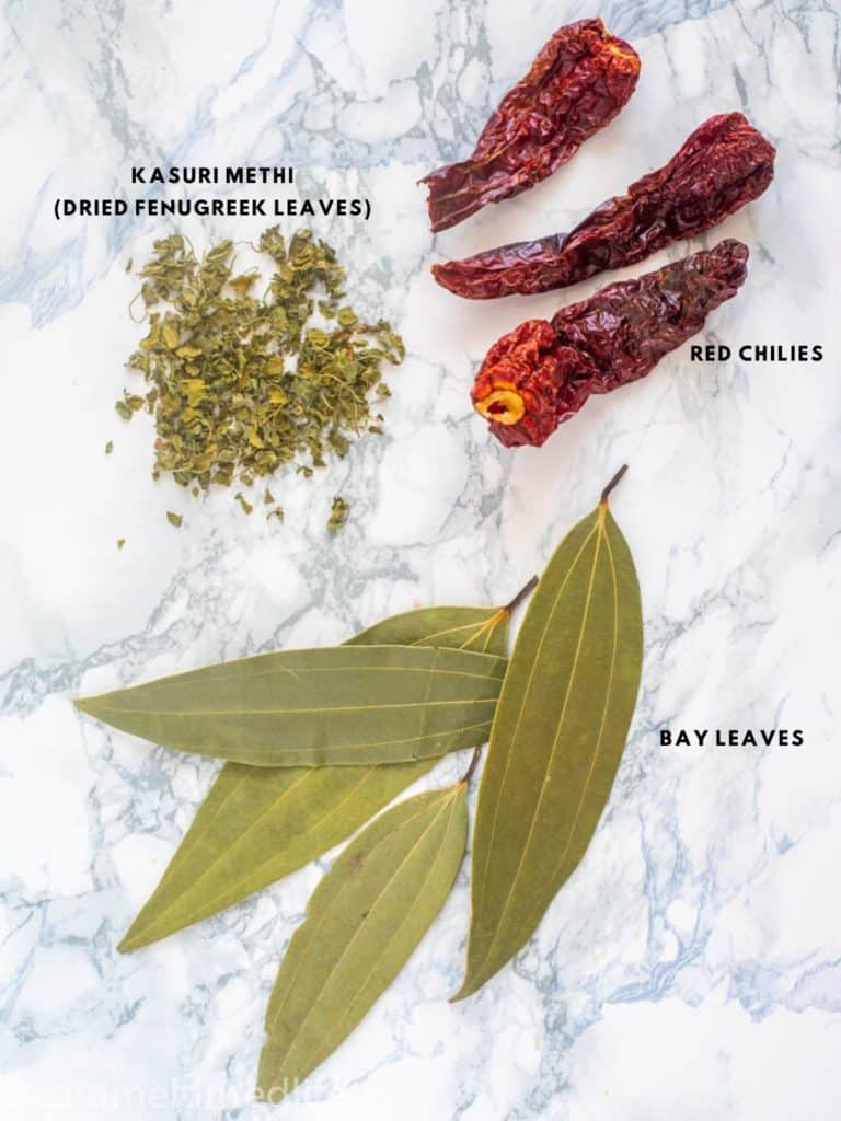 Dried Spices used in Indian Cooking - bay leaves, kashmiri chilies and kasuri methi