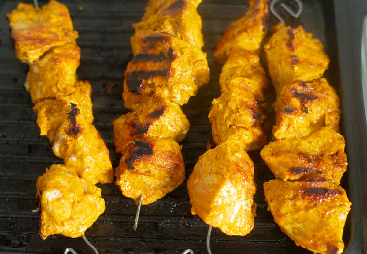 Skewered chicken on a grill