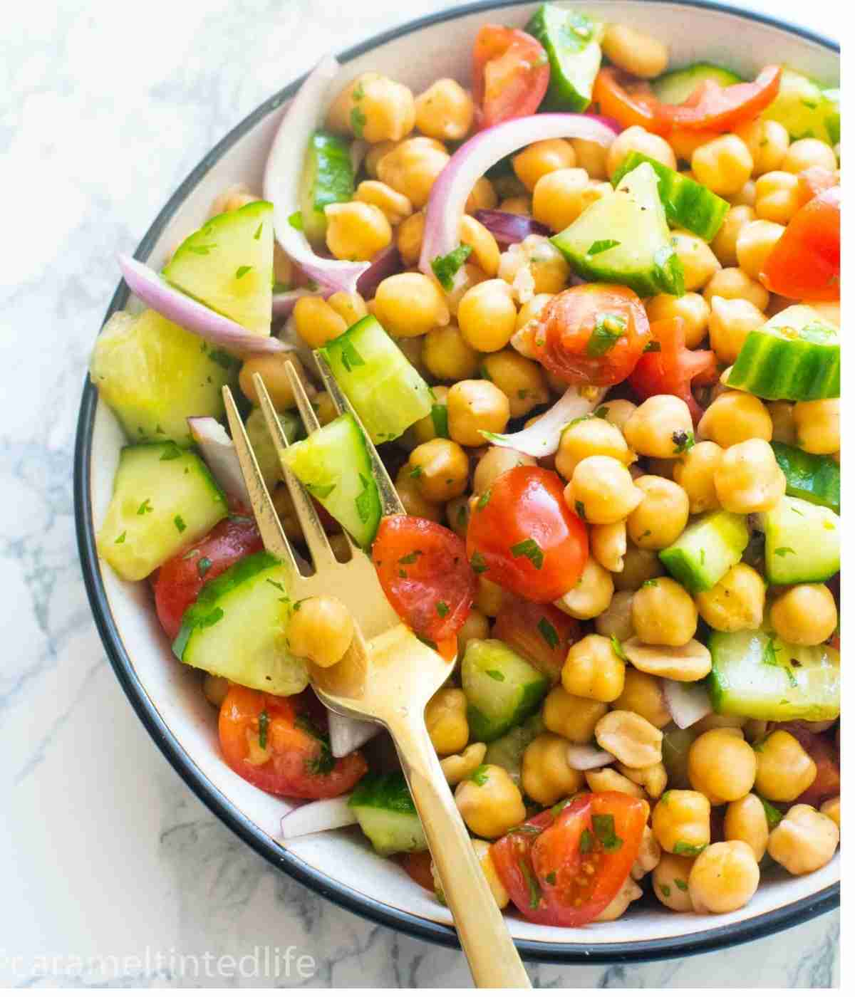 chickpea salad in a bowl with a fork
