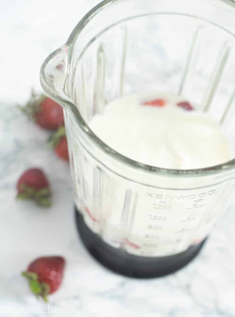 Yogurt and strawberries in a blender