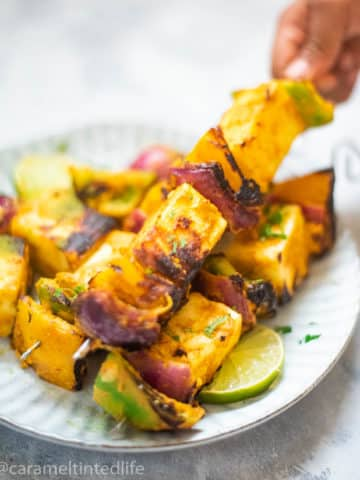 Paneer tikka on skewers