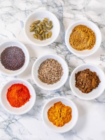 Spices powders on a white board