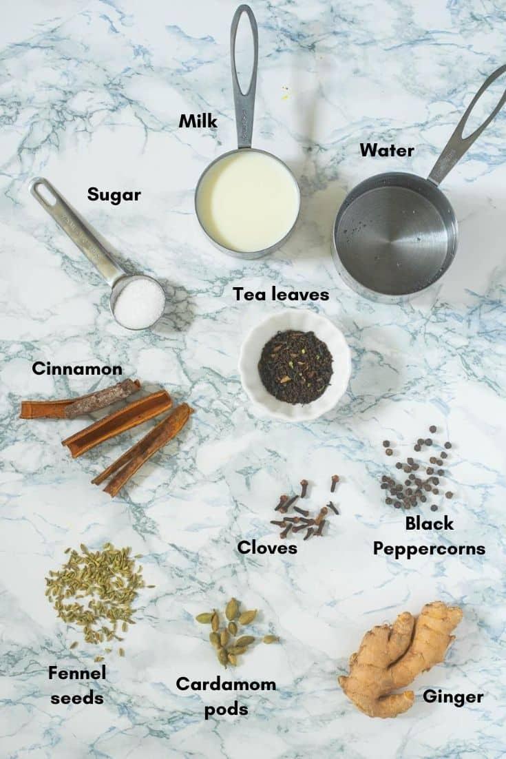 Tea leaves, Ginger, cardamon, cloves, fennel seeds, black pwppercorns, cinamon, tea leaves, sugar, water and milk