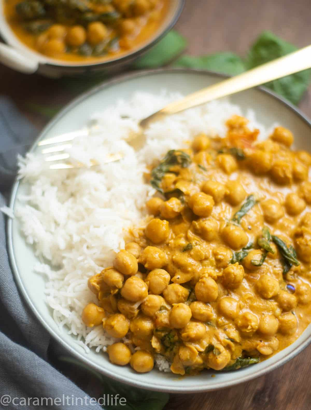 Close-up of chickpea coconut curry with spinach and rice