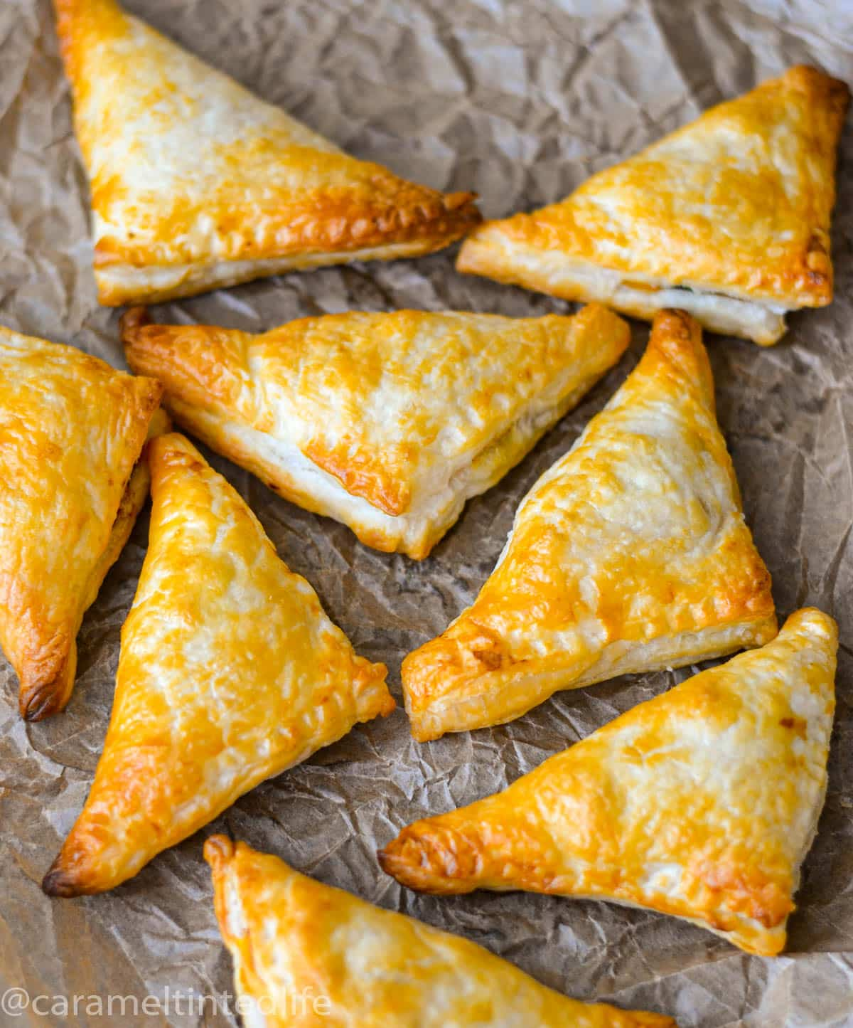 Golden brown puff pastry samosas out of the oven