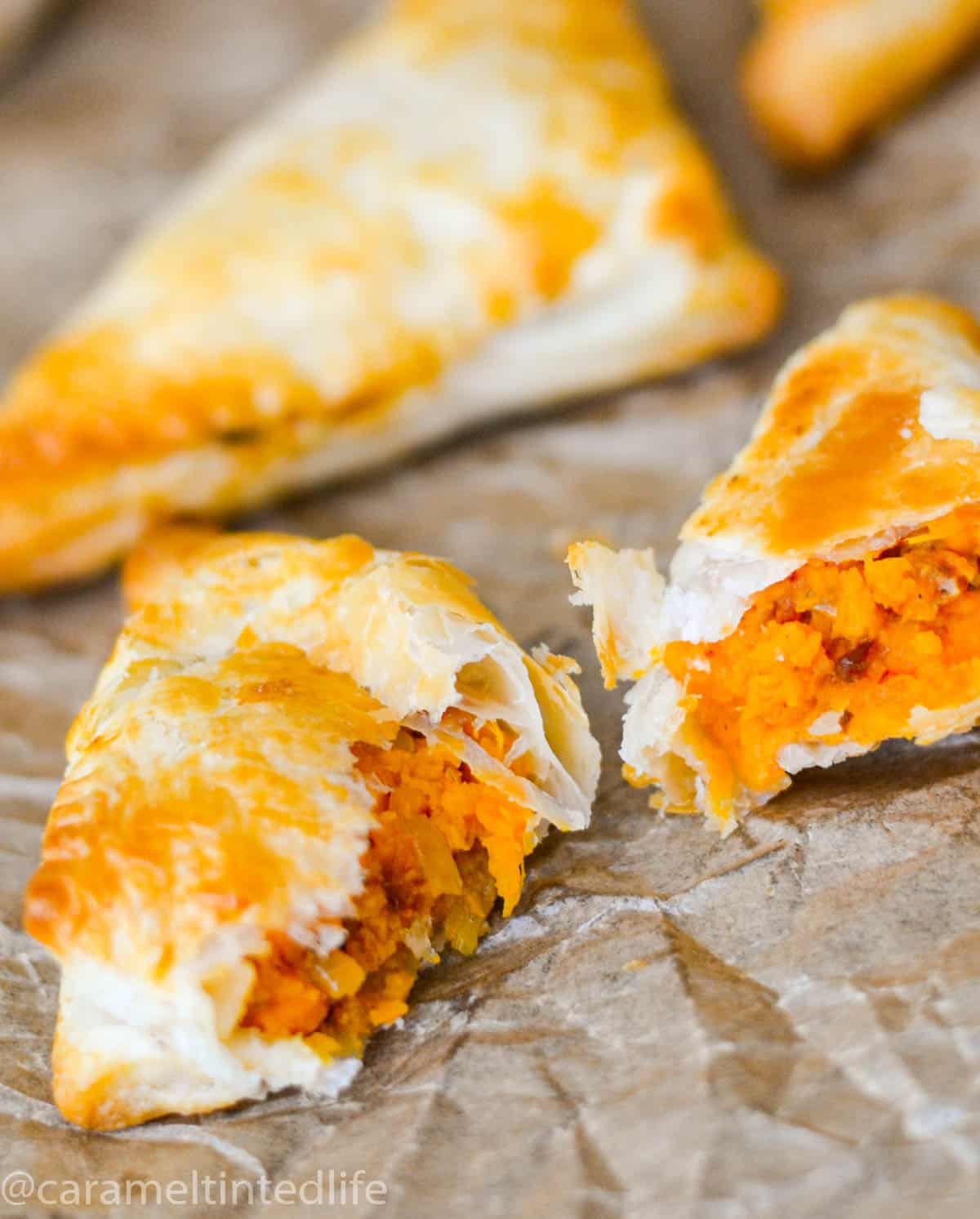Puff pastry samosas broken into two