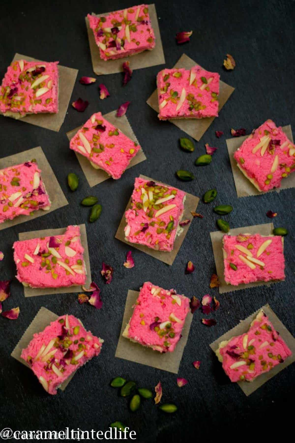 Rose flavored kalankand served on a black serving tray