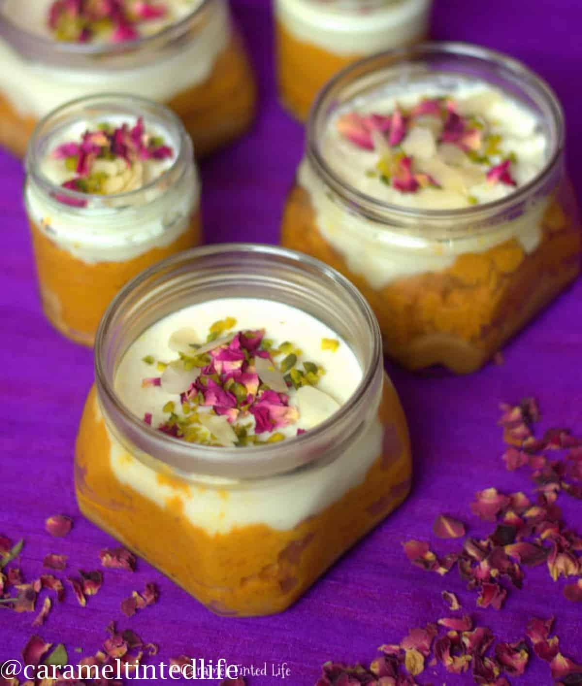 Jars with layers of phirni, dulce de leche, gajar halwa