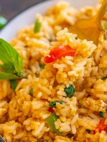 Basil fried rice on a bowl with a fork