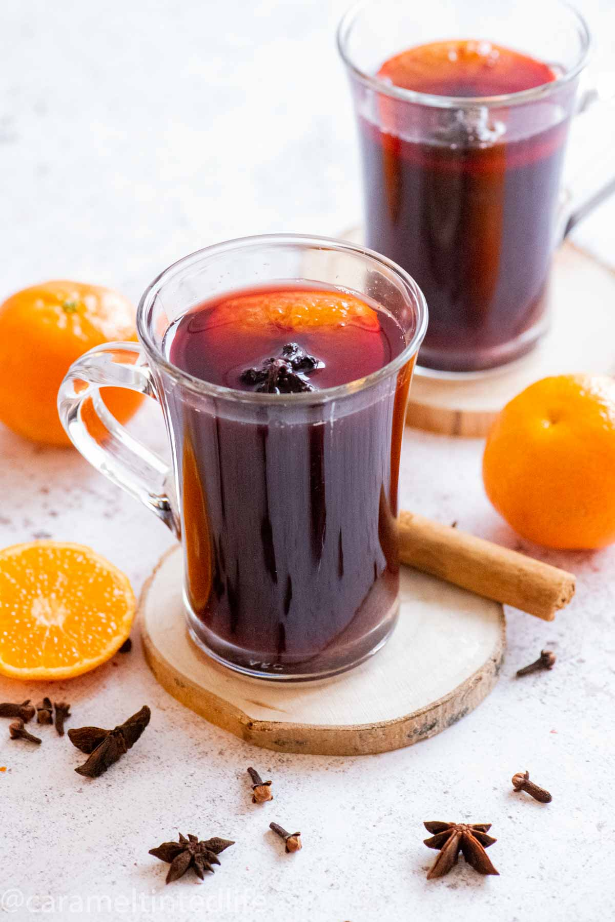 a glass of mulled wine in the foreground, one in the background