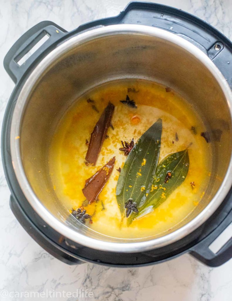 Instant Pot with orange zest, orange juice , bay leaves and spices
