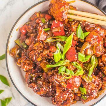 chopsticks holding sweet and sour crispy cauliflower