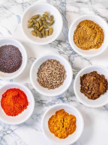 Spices in small white bowls
