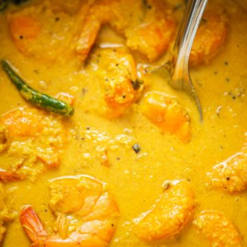 a pot of shrimp cooked in a curry
