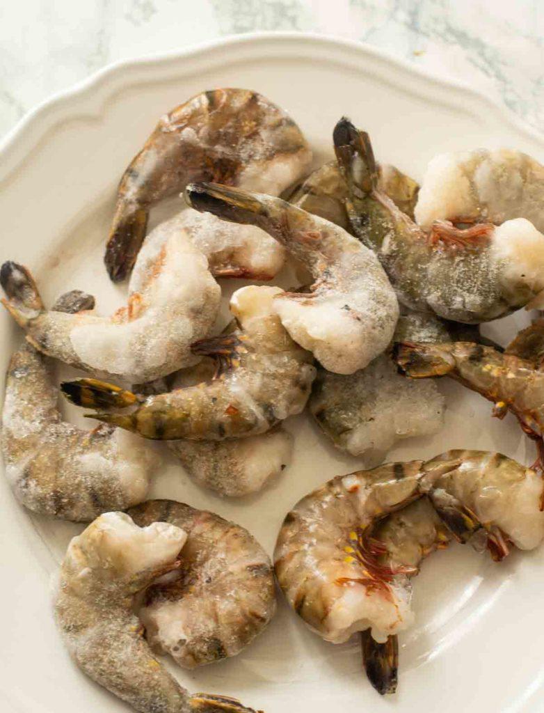 frozen shrimp on a white plate