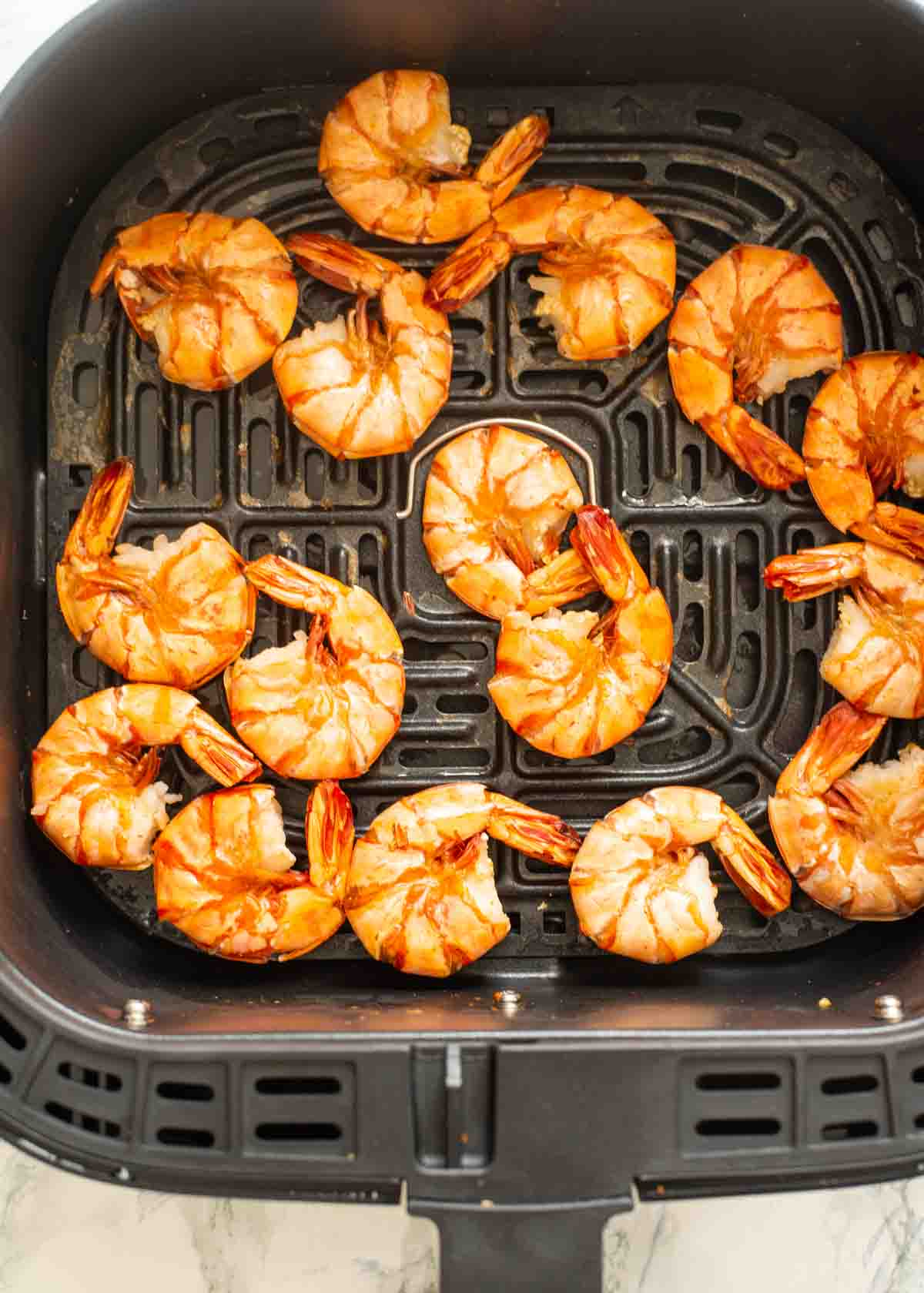 cooked shrimp in an Air Fryer basket