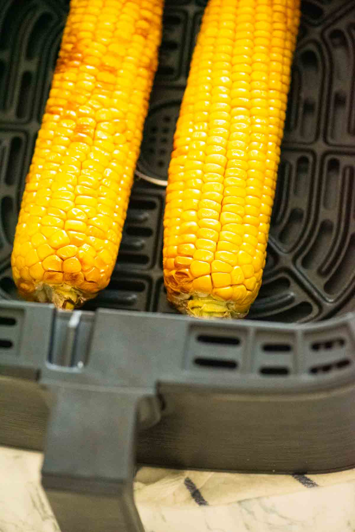 Air fryer basket with corn on the cob