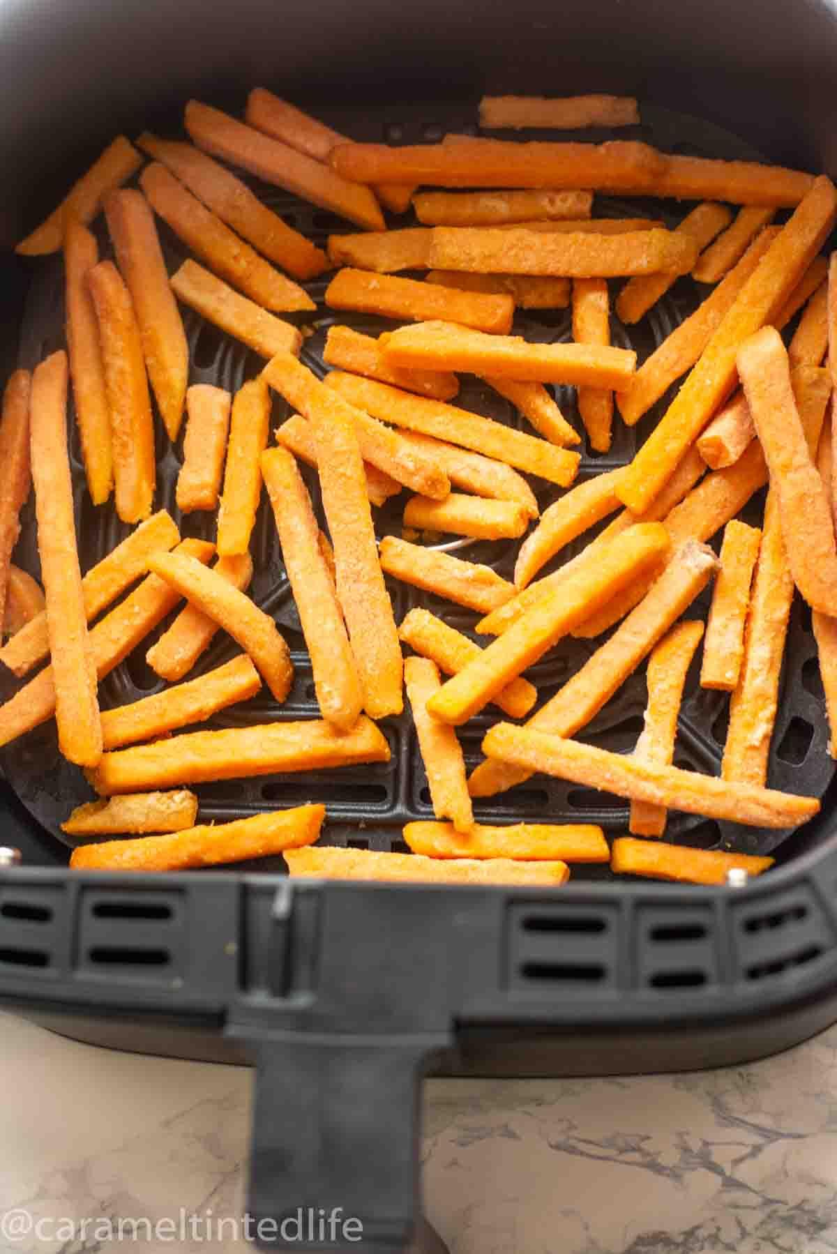 frozen sweet potato fries in an air fryer basket