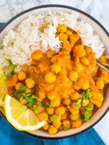 Cgickpea tagine in a bowl of rice