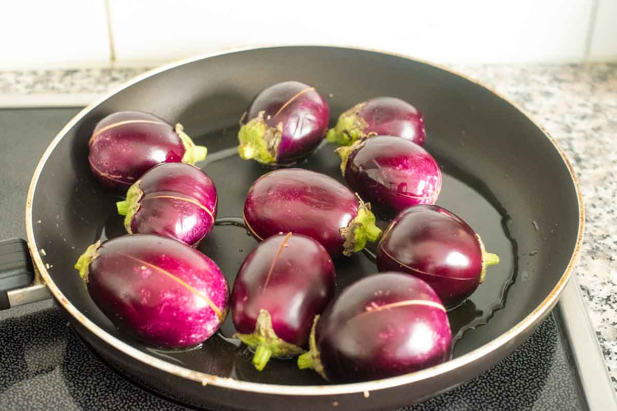 baby eggplant shallow frying in a saucepan