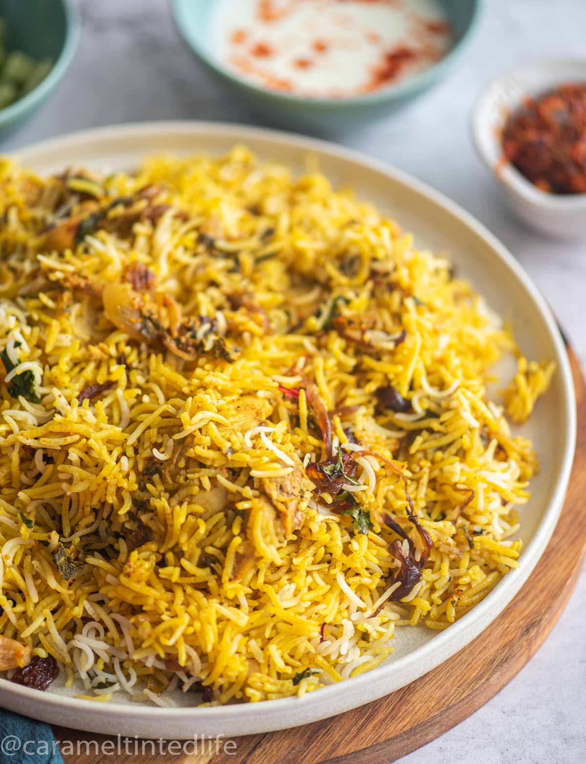 side view of chicken biryani on a plate