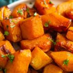 close up of butternut squash with parsley garnish