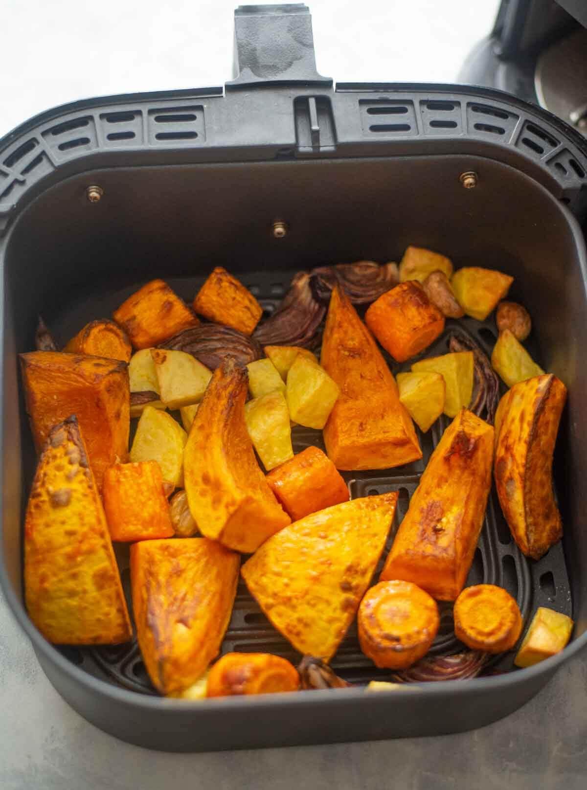 roasted pumpkin and veggies in air fryer basket